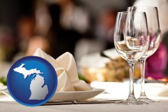 michigan map icon and a restaurant table place setting