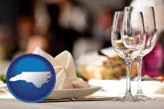 north-carolina map icon and a restaurant table place setting