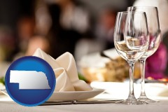 nebraska map icon and a restaurant table place setting