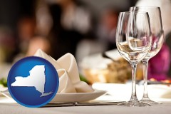 new-york map icon and a restaurant table place setting