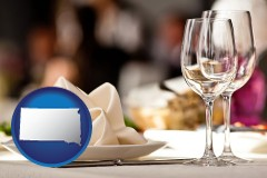 south-dakota map icon and a restaurant table place setting