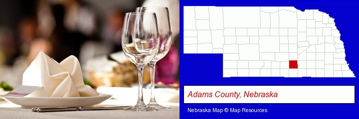 a restaurant table place setting; Adams County, Nebraska highlighted in red on a map