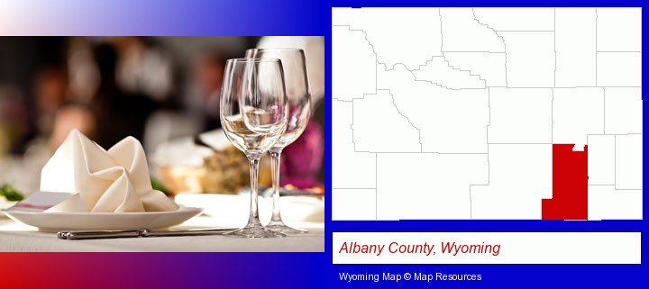 a restaurant table place setting; Albany County, Wyoming highlighted in red on a map