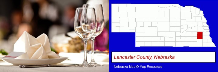 a restaurant table place setting; Lancaster County, Nebraska highlighted in red on a map